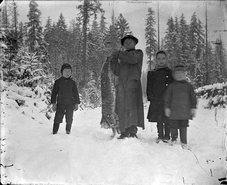 IMG_5823_Children_OneHoldingBobcat_Snow_Forest