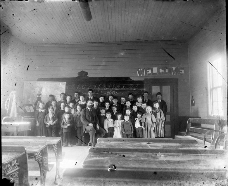 IMG_5862_Teacher_Students_1897Mar19_Snohomish_Organ_Desks
